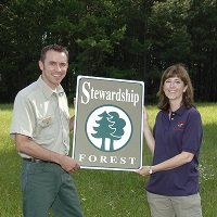TFS FORESTER PRESENTS A CERTIFIED FOREST STEWARD AWARD TO A LANDOWNER